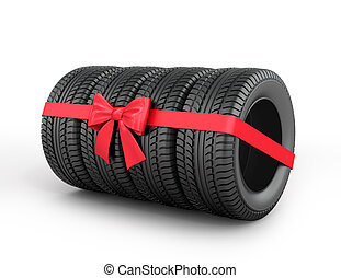 A set of rubber tires with ribbon and bow