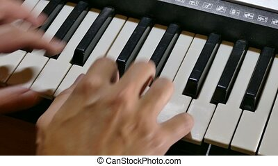 synthesizer playing man piano hand run over keys -...