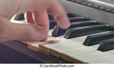 playing man synthesizer piano hand run over keys - playing...