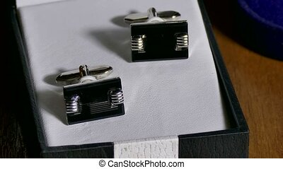Man Cufflinks are in box on the table - Man Cufflinks are in...