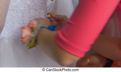 The bride dress knotted strings behind the back - The bride...