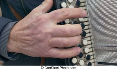 man playing the accordion accordion arm