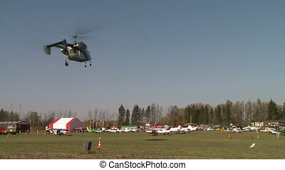 View of helicopter turns over airfield - View of modern...