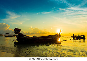 Seascape during sunrise with long tail boat Beautiful...