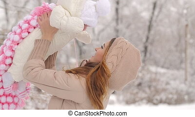 Happy Mother with Baby in Winter - mother with his little...