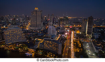 aerial night scene of bangkok sky scraper beside chaopraya...