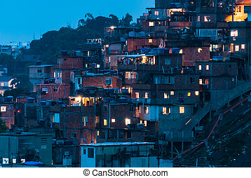 Aerial view at favela houses by night in Rio de Janeiro...