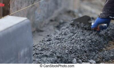 trowel worker works - Worker smoothing trowel concrete...