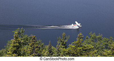 Water plane - single engined seaplane coming into land with...