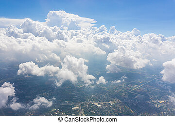 Blue sky white cloud. city with tall buildings. on the sky
