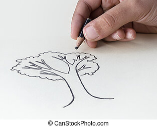 A child drawing a tree with a very short pencil stub expressing the concept of the conservation of the Earth's Resources