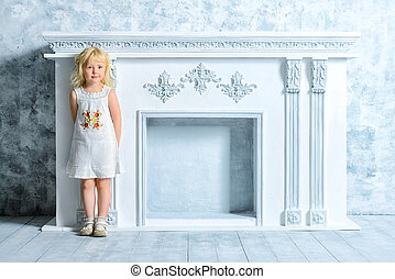 vintage child - Little angelic girl in white dress standing...