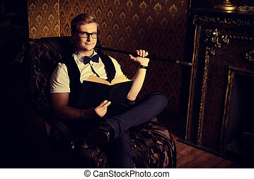 vintage man - Handsome well-dressed man sitting by the...