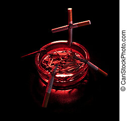 cigarette cross in ashtray, dark background