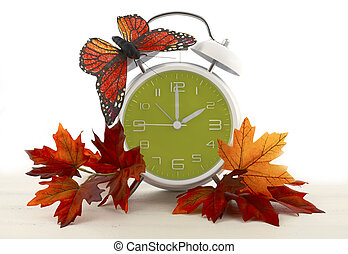 Daylight Saving Time Ends concept with Autumn Fall theme. -...