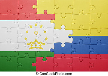 puzzle with the national flag of colombia and tajikistan ....