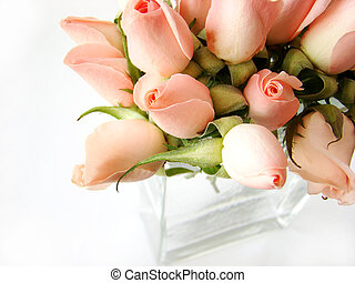 Little pink roses bouquet on white background