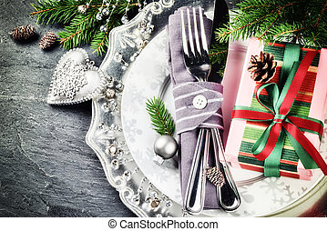 Christmas table setting in silver tone with gift box