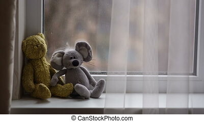 Toys on the Windowsill - toys lie on the windowsill and...