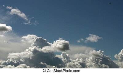 Flow of Clouds in the Blue Sky - Majestic clouds illuminated...