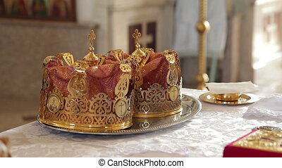 Orthodox Wedding Crowns - wedding crowns are on the table