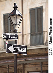 French Quarter - Street lamp with Rue St Louis sign in the...
