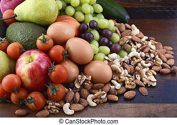 Healthy Diet with fresh fruit, eggs, nuts and vegetables. -...