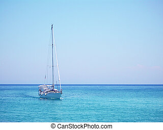 Yacht in the Mediterranean sea - Single white yacht drifting...