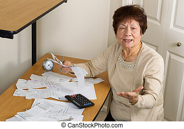 Older woman angry with her financial bills