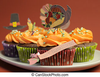 Happy Thanksgiving cupcakes with turkey, feast, and pilgrim...