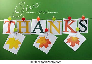 Give Thanks message spelling in letters hanging from pegs on...