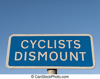 Cyclist Dismount - Cyclist dismount road sign against a...