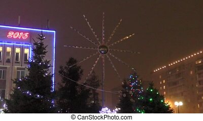 The lights on the Christmas tree on new years Eve -...