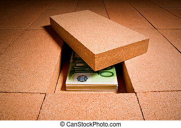 cash in hiding place - personal savings under a brick in the...