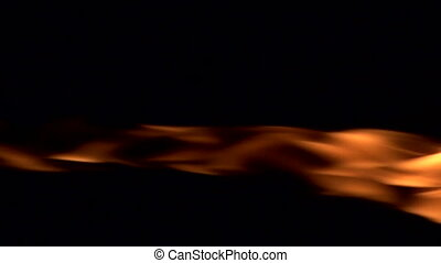 Flames on a Black Background - The jet of gas flame on a...