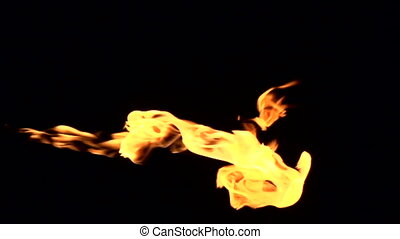 Fire Flares on a Black Background - The jet of gas flame on...