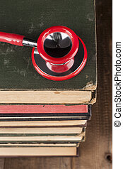 stethoscope On Books Pile - Red Stethoscope Closeup on Old...