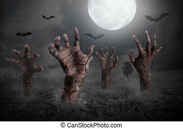 zombie hand rising out of the ground - Halloween background...