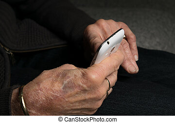 Grandma checking her smartphone for new activity on social...