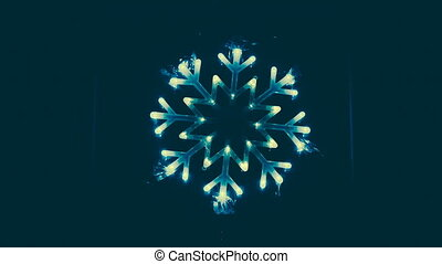 Colorful lights moving in the form of snowflakes.