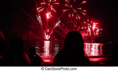 people watching fireworks on sea