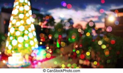 blurred christmas tree in city seamless loop