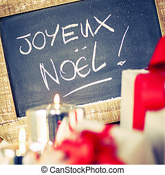 Joyeux Noel - Joyeux Noel on a slate with gifts and candle...