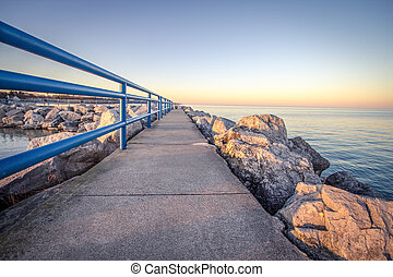 Summer Stroll Along The Coast - Harbor break wall along the...