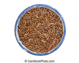 ruby rice - many dry ruby rice corns in small blue cup...