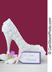 Wedding concept high heel shoe on marsala background. -...