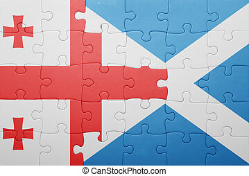 puzzle with the national flag of georgia and scotland...