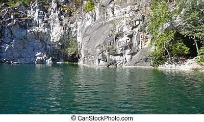 Swimming in marble quarry in Ruskeala, Karelia, Russia