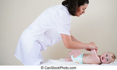 Physiotherapy - Baby boy getting physiotherapy, legs...