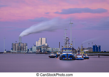 Port of Eemshaven at sunset - Port of Eemshaven with ships...